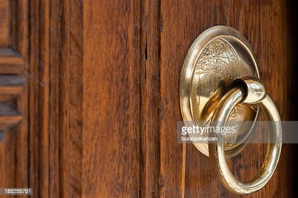vintage image of ancient door knocker on a wood - brass stock pictures, royalty-free photos & images