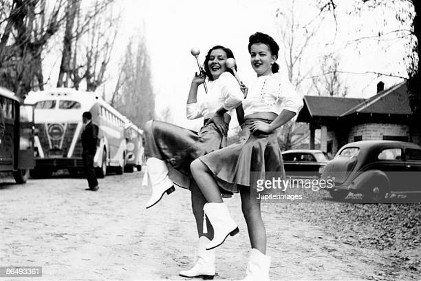 vintage image of baton twirlers - cheerleader photos stock photos and pictures