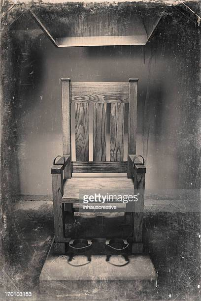 vintage image of electric chair - electric chair stock photos and pictures