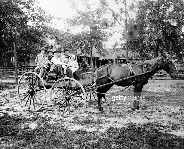 Vintage image of family in horse drawn carriage