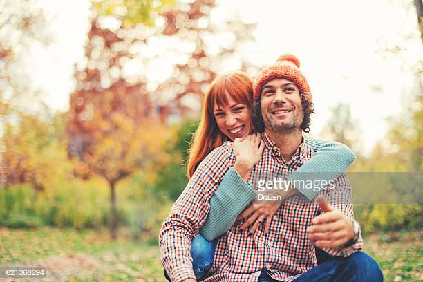 vintage image of loving couple in park in autumn - desaturated stock pictures, royalty-free photos & images