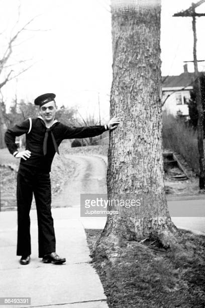 Vintage image of sailor with hand on tree