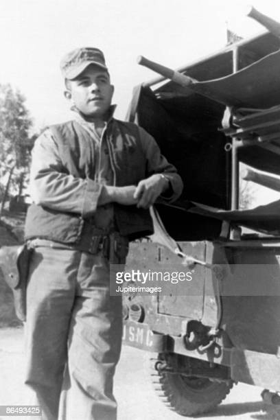 vintage image of soldier leaning on truck - army soldier photos stock photos and pictures