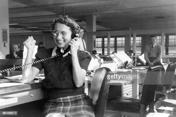 vintage image of woman using telephone in office - history stock pictures, royalty-free photos & images