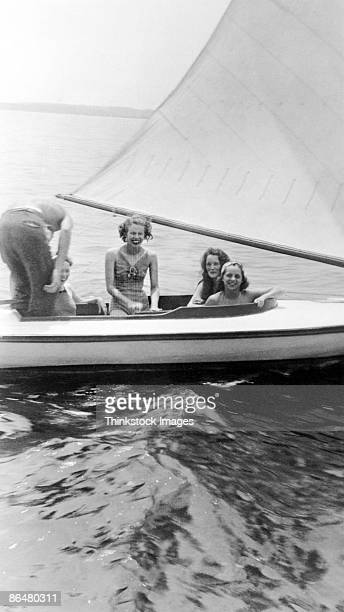Vintage image of women with man in sailboat