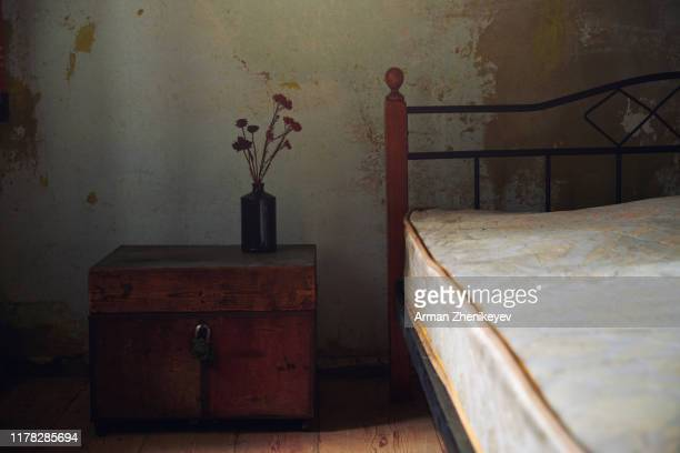 vintage interior with bed and wooden trunk. nicely fits for book cover - 19th century style stock pictures, royalty-free photos & images