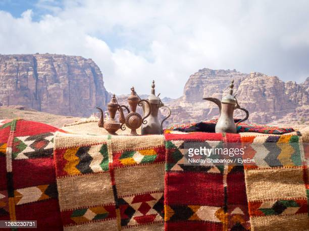 vintage kettles and carpets against mountains - tradition stock pictures, royalty-free photos & images
