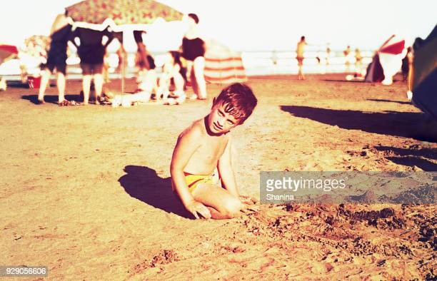 vintage kid in the beach - archival stock pictures, royalty-free photos & images