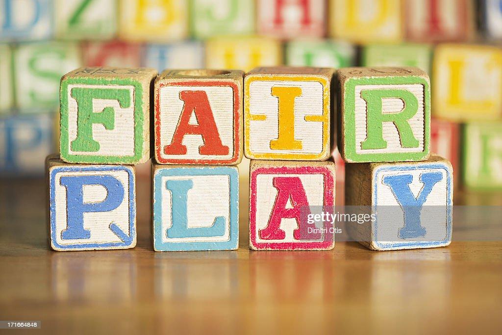 Vintage kids alphabet blocks saying FAIR PLAY : Stock Photo