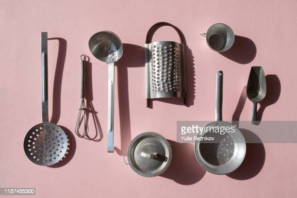 vintage kitchen utensils on the pink background - kitchen utensil stock pictures, royalty-free photos & images