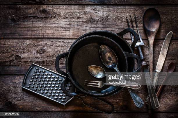vintage kitchen utensils shot from above on rustic wooden table - cooking utensil stock photos and pictures
