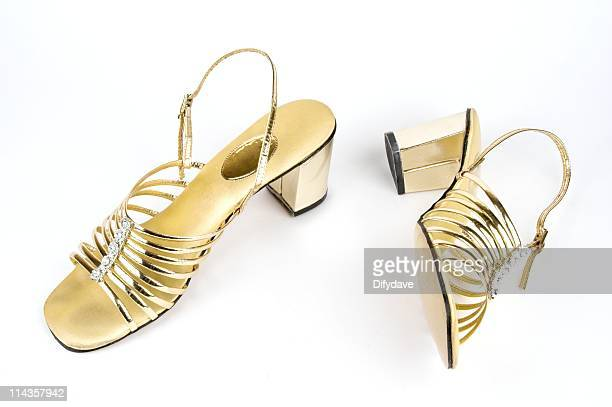 vintage ladies gold sandals - gold shoe stock pictures, royalty-free photos & images