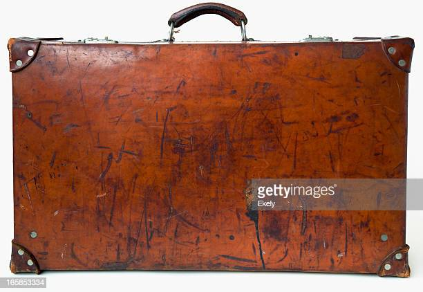 Vintage leather suitcase  standing on the floor.