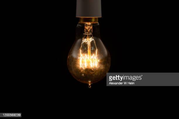 vintage lightbulb - heat stock pictures, royalty-free photos & images