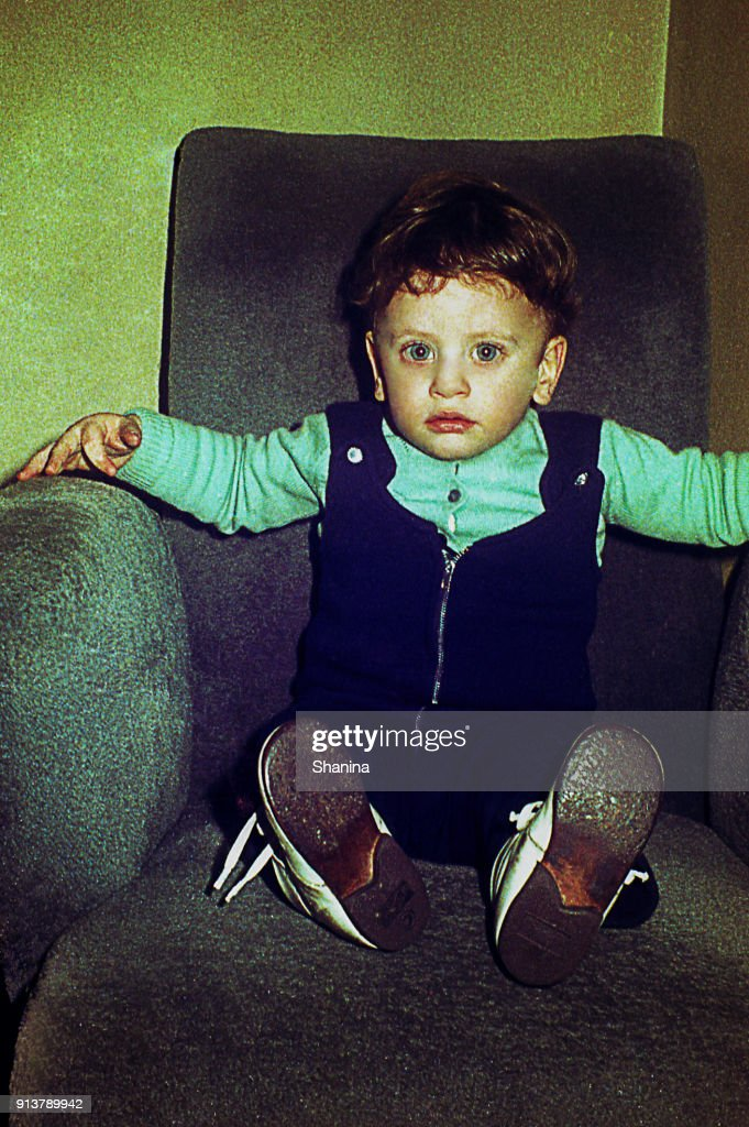 Vintage Little Boy On A Big Armchair High-Res Stock Photo ...