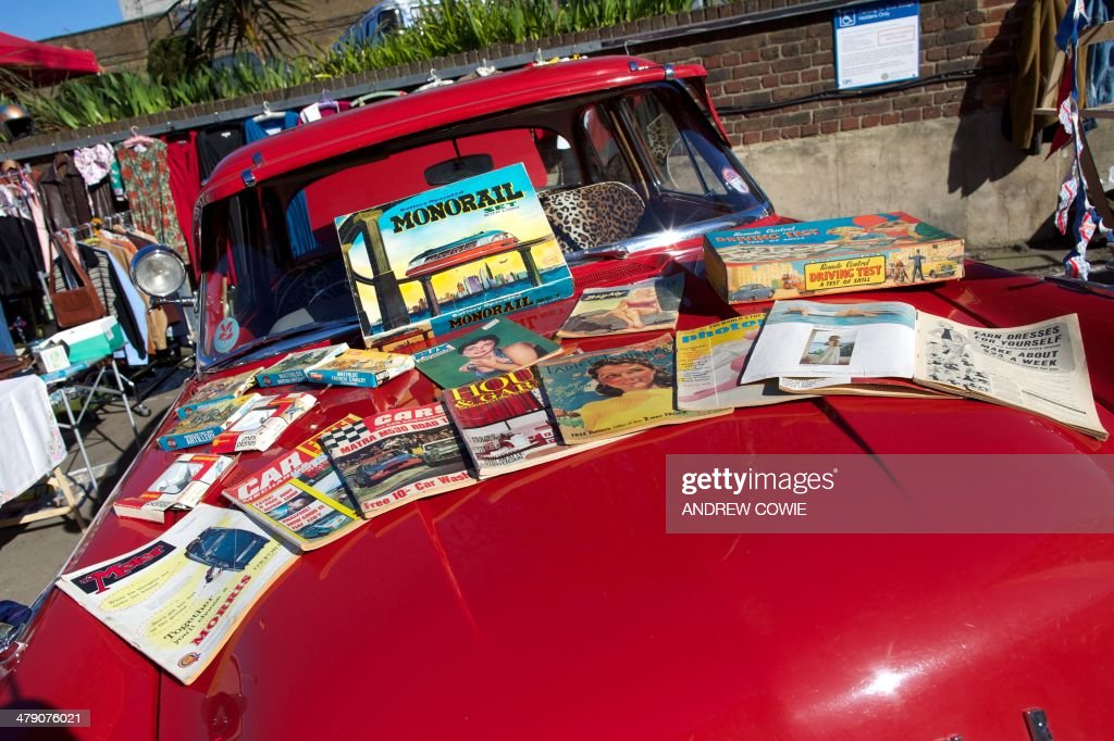 Vintage magazines are displayed on a classic car during the ...