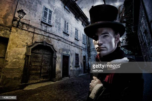vintage man in tophat and cobblestone street - top hat stock pictures, royalty-free photos & images