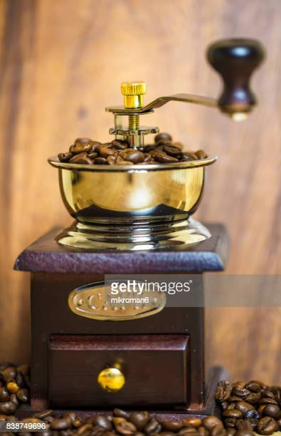 Vintage manual coffee grinder and coffee beans