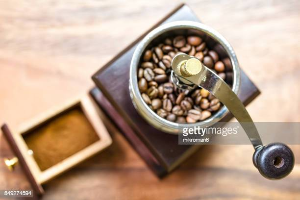 Vintage manual coffee grinder and coffee beans