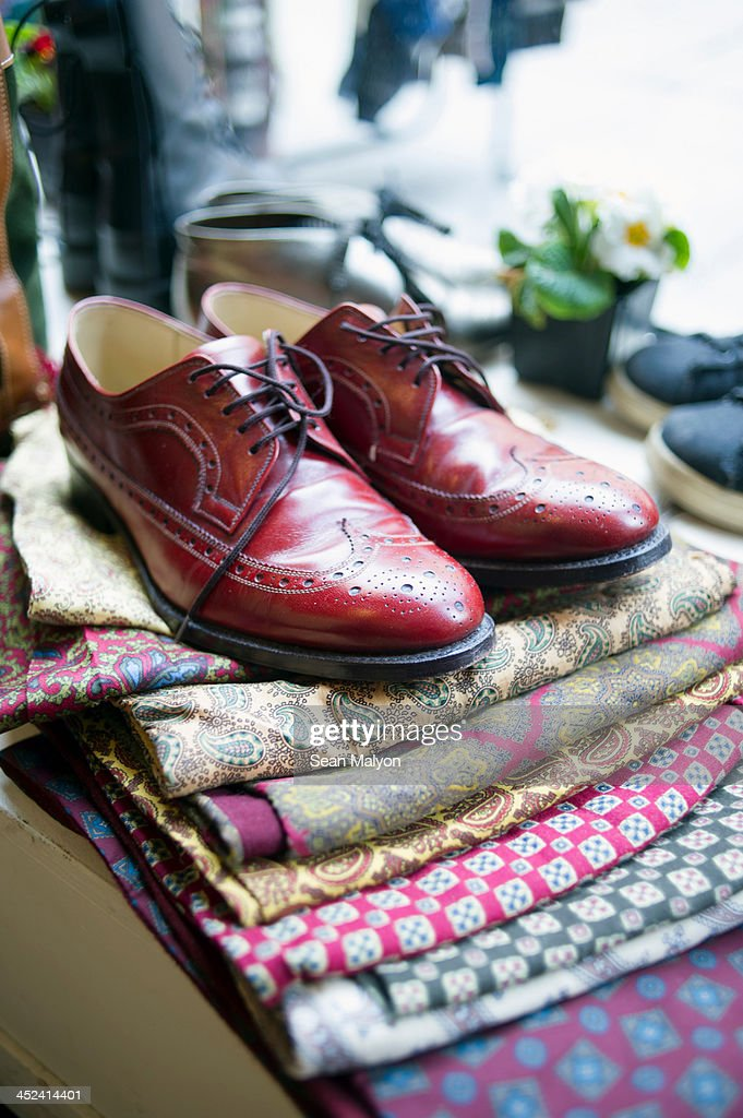 Vintage men's shoes on top of pile of fabric : Stock Photo