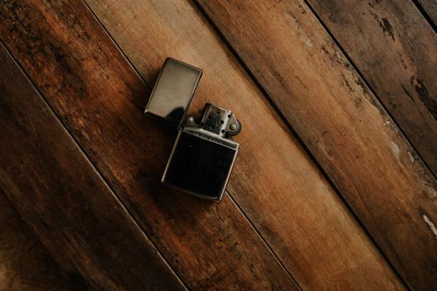 Vintage metal windproof lighter on wooden tables