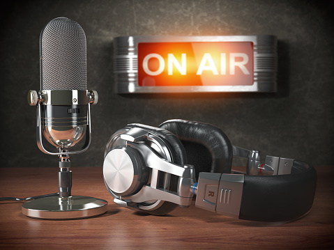 Vintage microphone  and headphones with signboard on air. Broadcasting radio station concept. 848658582