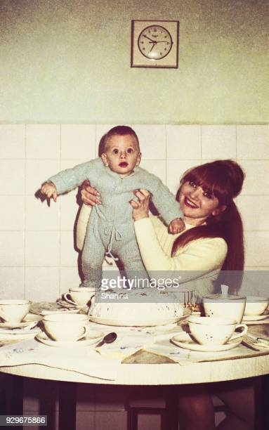 vintage mommy and baby in the kitchen - photograph stock pictures, royalty-free photos & images