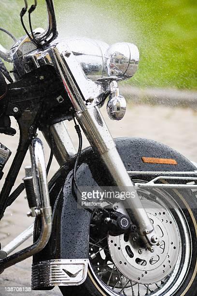 Vintage motorbike being sprayed