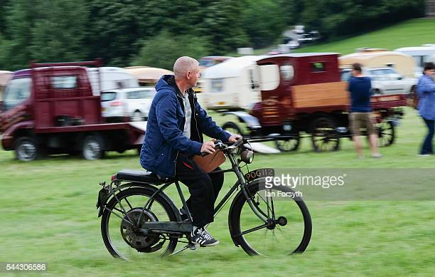 A vintage motorcycle is ridden during the annual Duncombe Park Steam Fair on July 3 2016 in Helmsley England Held in the picturesque grounds of...