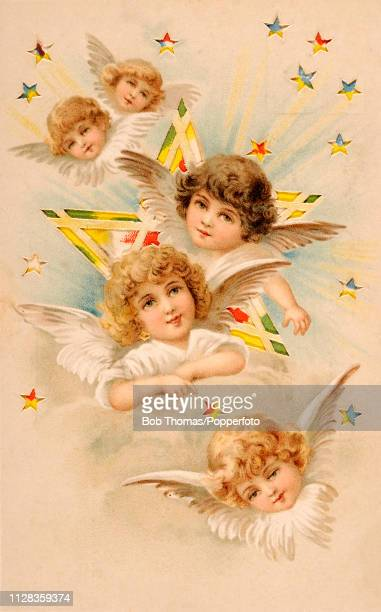 A vintage novelty postcard illustration featuring five baby angels amidst the stars along with Easter greetings circa 1900