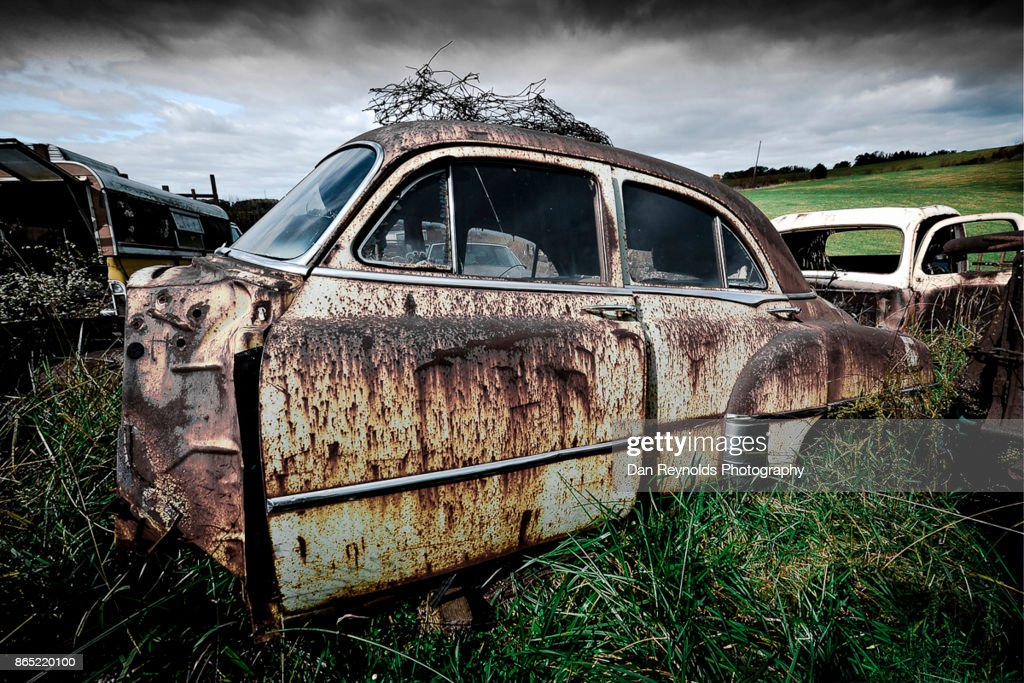 Vintage Old Rusty Car Missing Front Stock Photo | Getty Images