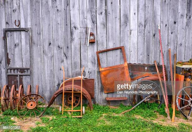 Vintage old tractor against barn