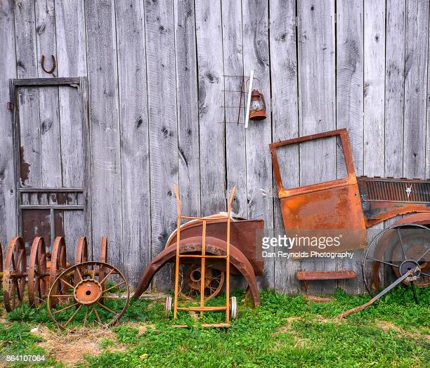 Vintage old tractor against barn-Square