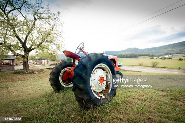 vintage old tractor at sunset - recessed lighting stock pictures, royalty-free photos & images