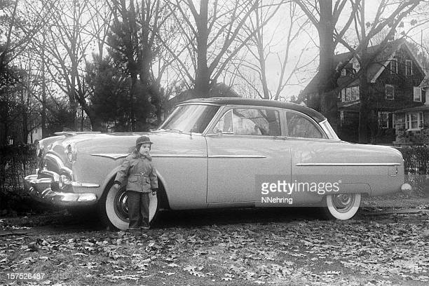 vintage Packard Coupe with little boy 1955, retro