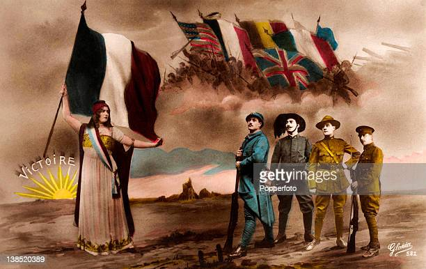 """Vintage patriotic postcard showing a World War One scene involving the national flags of the allies, four soldiers, a sunrise proclaiming """"Victory"""",..."""