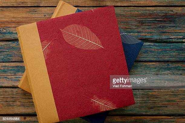 Vintage photo albums or books on a rustic wood background