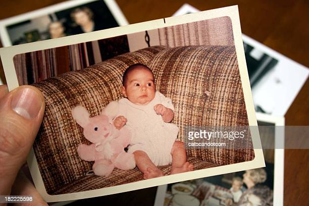 Vintage photo of baby and stuffed toy rabbit