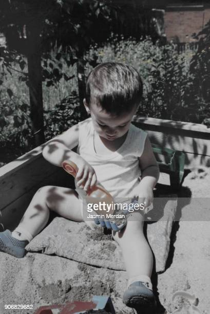 Vintage photo of kid outdoors