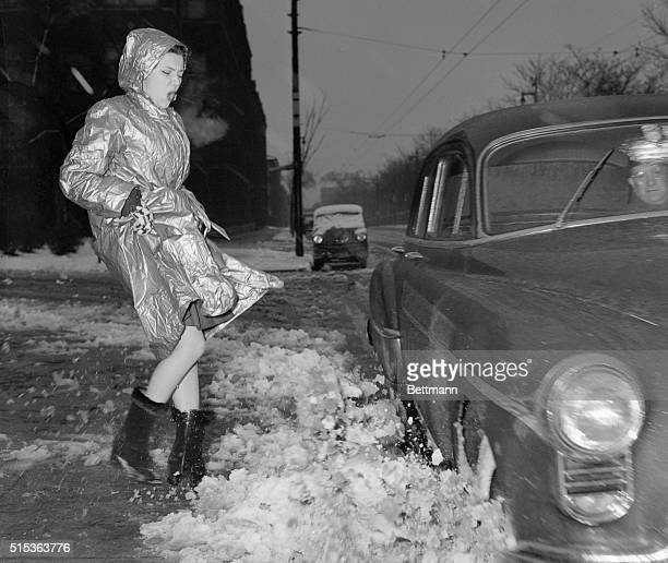 Vintage photograph of trendy young woman splashed over with semi melted snow