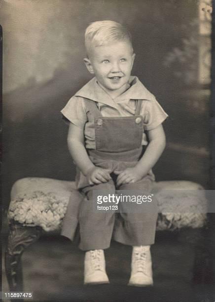 Vintage photograph portrait. Antique. Little boy. 1940s era.