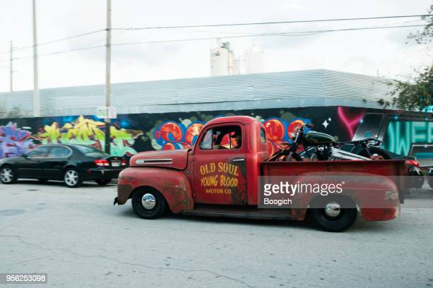 vintage pickup truck driving in wynwood miami usa - low rider stock pictures, royalty-free photos & images