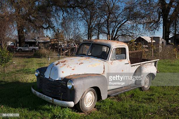 A vintage pickup truck observed in a yard in Los Molinos a small town in Tehama County California
