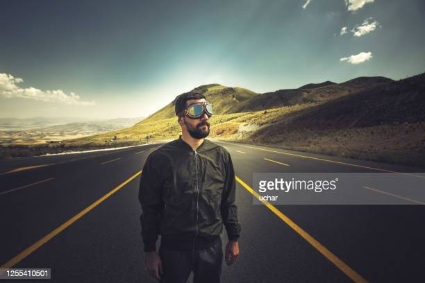 vintage pilot with leather cap and aviator glasses - bomber jacket stock pictures, royalty-free photos & images