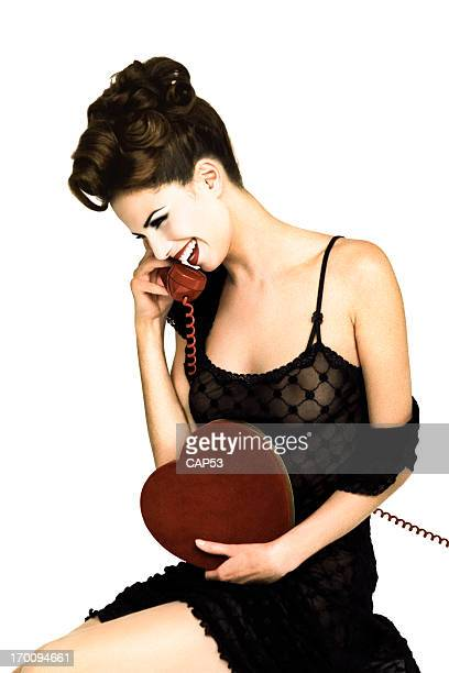 Vintage Pin-Up Girl Holding A Chocolate Box Talking On Telephone