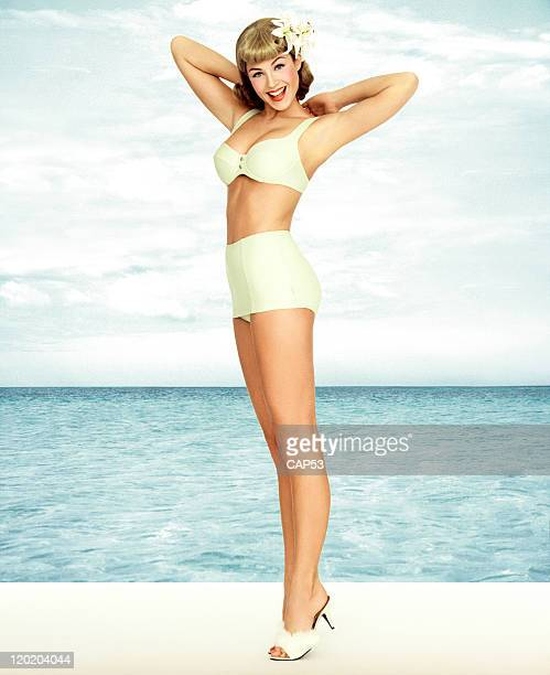 Vintage Pin-up Girl Wearing Bathing Suit At The Ocean