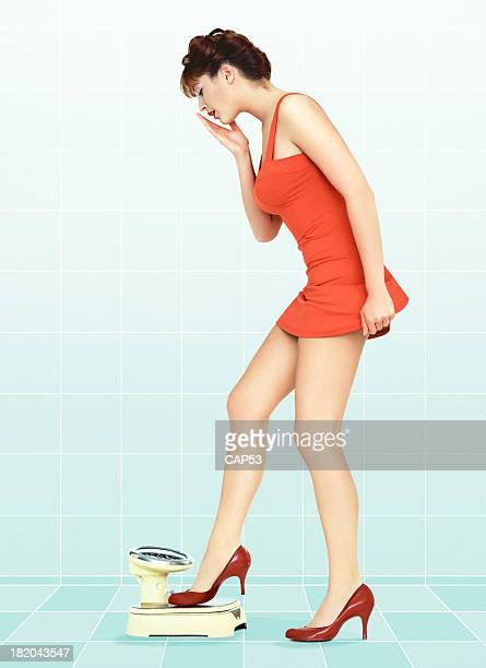 Vintage Pin-Up Stepping On Scale For A Overweight Control