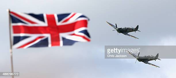 Vintage planes fly in formation as part of a Battle of Britain 75th Anniversary flypast at Goodwood Aerodrome at Goodwood on September 15 2015 in...
