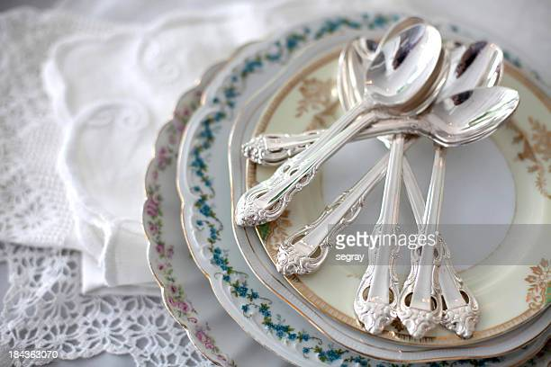 Vintage plates with silver teaspoons