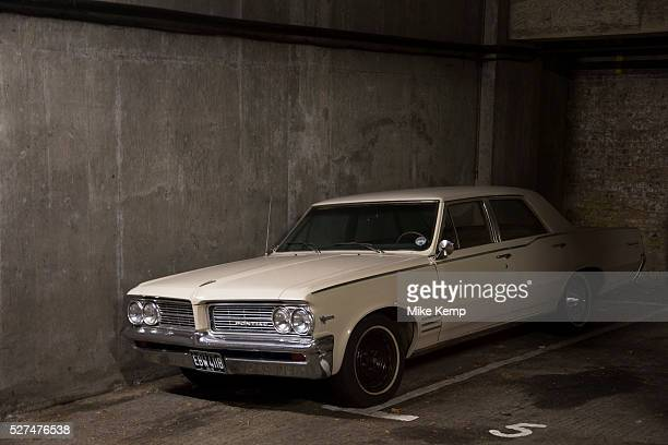 Vintage Pontiac V8 326 car in an underground garage. American classic car. London, UK.